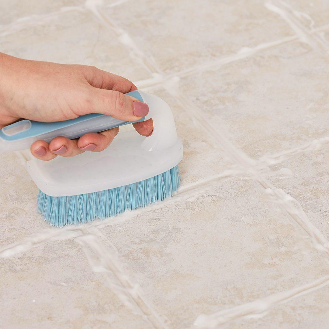 blue-cleaning-brush-tile-floor-27d7b079